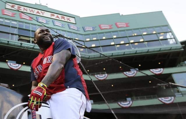 Boston Red Sox designated hitter David Ortiz laughs as he takes a break from hitting during a baseball workout at Fenway Park, Friday, Oct. 18, 2013, in Boston. The Red Sox are scheduled to host the Detroit Tigers in Game 6 of the American League baseball championship series on Saturday. (AP Photo/Charles Krupa)