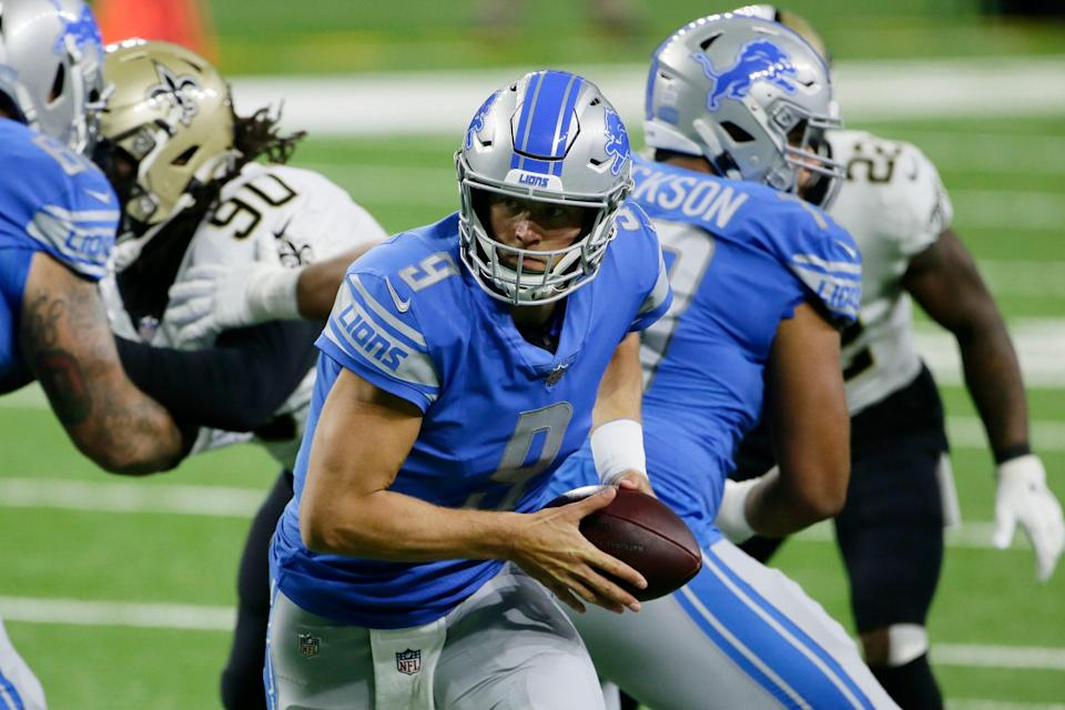 Lions quarterback Matthew Stafford prepares to hand off during the first half against the Saints on Sunday, Oct. 4, 2020, at Ford Field.