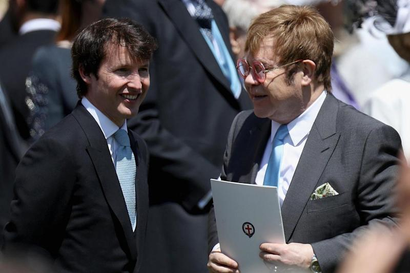 James Blunt has long been friendly with the young royals, pictured here with Elton John at Prince Harry and Meghan Markle's wedding (Getty Images)