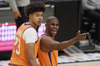 Phoenix Suns guard Chris Paul, right, complains to a referee about a call as forward Cameron Johnson looks on during the first half in Game 3 of the NBA basketball Western Conference Finals against the Los Angeles Clippers Thursday, June 24, 2021, in Los Angeles. (AP Photo/Mark J. Terrill)