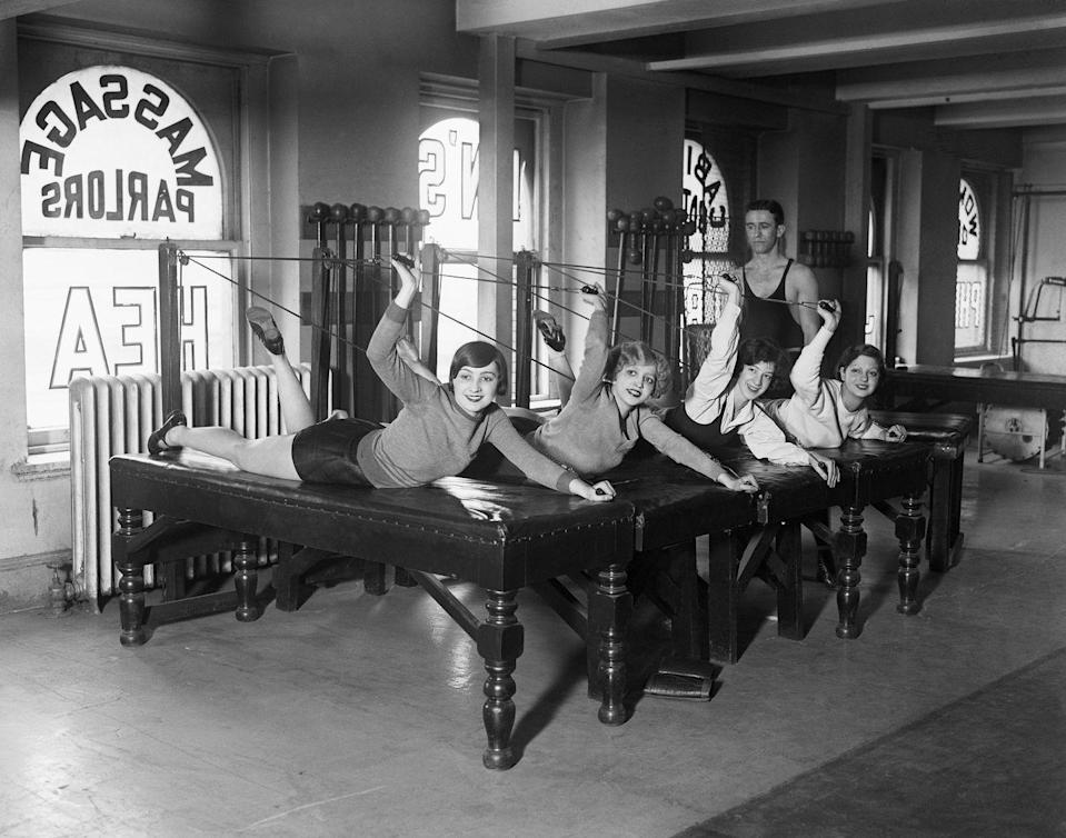 "<p>This photo from New York City in 1928 shows chorus girls from the ""Lady, Be Good"" show in a gym on ""reducing"" tables. Back then, if you wanted to lose weight, you said you wanted to <a href=""https://www.rd.com/article/1920s-advice-weight-advice/"" rel=""nofollow noopener"" target=""_blank"" data-ylk=""slk:&quot;reduce&quot; weight"" class=""link rapid-noclick-resp"">""reduce"" weight</a>, or that you were on a ""reduction diet.""<br></p>"