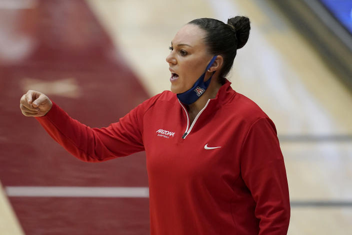 Arizona head coach Adia Barnes gestures toward players during the first half of her team's NCAA college basketball game against Stanford in Stanford, Calif., Monday, Feb. 22, 2021. (AP Photo/Jeff Chiu)