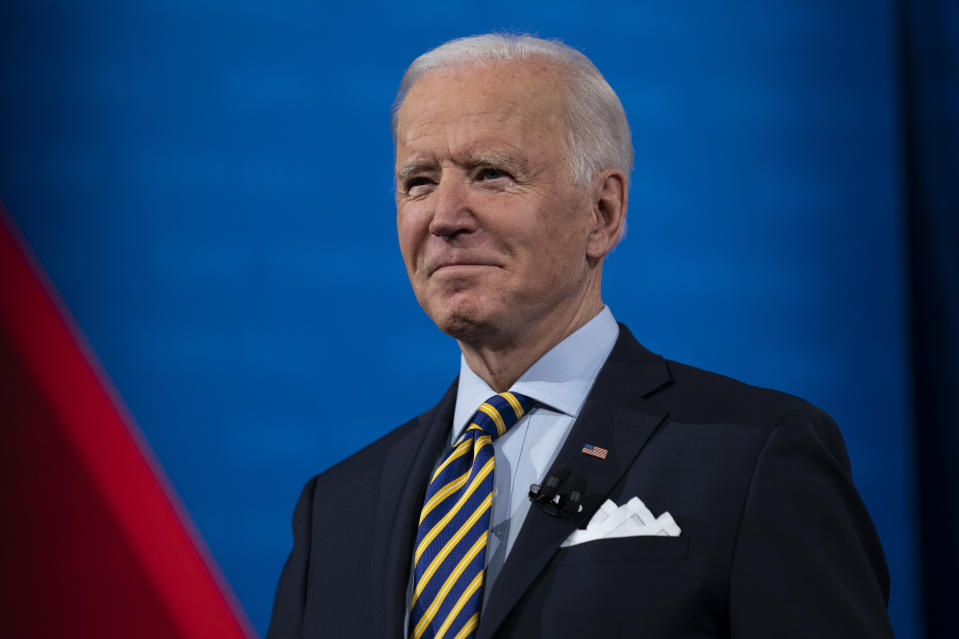 President Joe Biden talks with audience members as he waits for a commercial break to end during a televised town hall event at Pabst Theater, Tuesday, Feb. 16, 2021, in Milwaukee. (AP Photo/Evan Vucci)