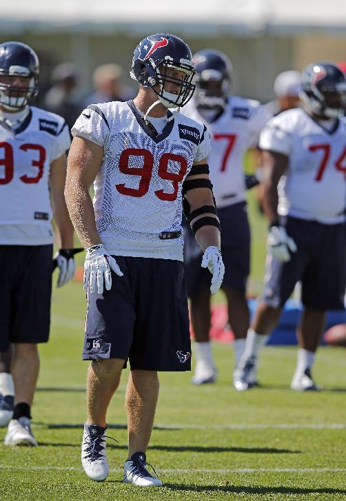 Houston Texans defensive end J.J. Watt warms up during a joint practice between the Denver Broncos and Texans on Tuesday, Aug. 19, 2014, in Englewood, Colo. (AP Photo/Jack Dempsey)