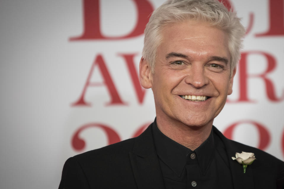 Phillip Schofield poses for photographers upon arrival at the Brit Awards 2018 in London, Wednesday, Feb. 21, 2018. (Photo by Vianney Le Caer/Invision/AP)
