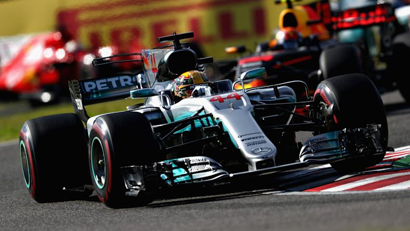 Hamilton closes on championship with Suzuka win as Vettel retires