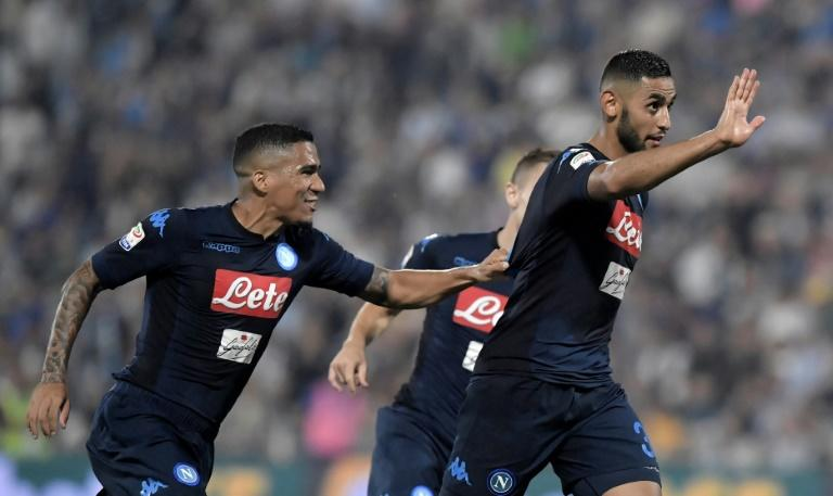 Napoli's defender Faouzi Ghoulam (R) celebrates after scoring a goal during the Serie A football match against SPAL September 23, 2017