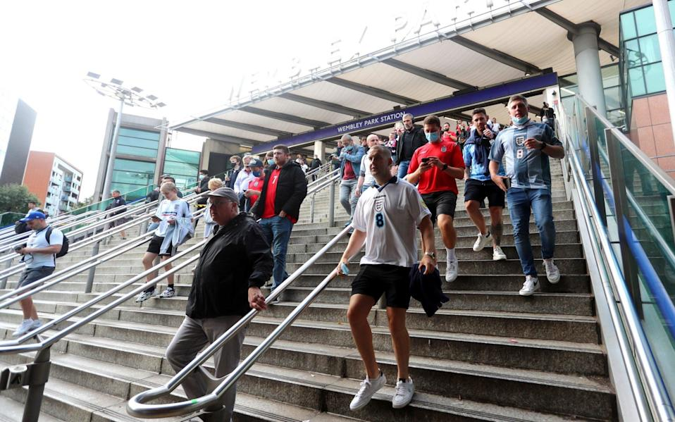 Fans arrive from the tube station - Chloe Knott - Danehouse/Getty Images