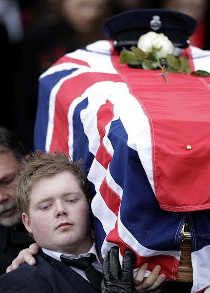 Kyle Black carries the coffin of his father David Black from Molesworth Presbyterian Chuch in Cookstown, Northern Ireland, Tuesday, Nov. 6, 2012. The father of two was shot dead by Irish Republican dissidents on the M1 in County Armagh on Thursday last week as he drove to work at Maghaberry Prison. (AP Photo/Peter Morrison