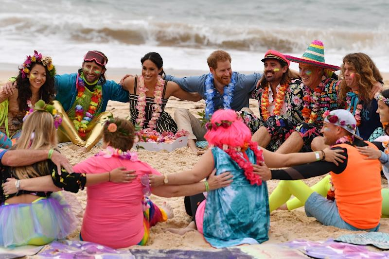 Harry and Meghan join a 'Fluro Friday&#x27 session run by OneWave a local surfing community group that raises awareness about mental health and wellbeing at Sydney's Bondi Beach