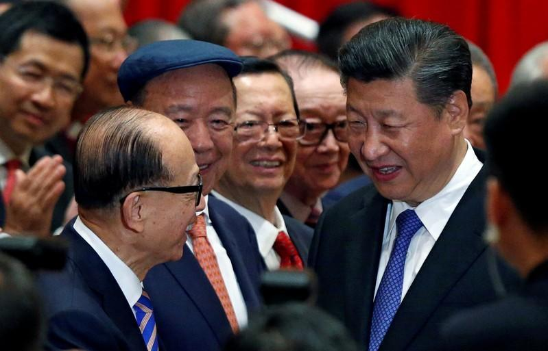 FILE PHOTO: Chinese President Xi Jinping is greeted by tycoon Li Ka-shing before a photo session during Xi's visit in Hong Kong