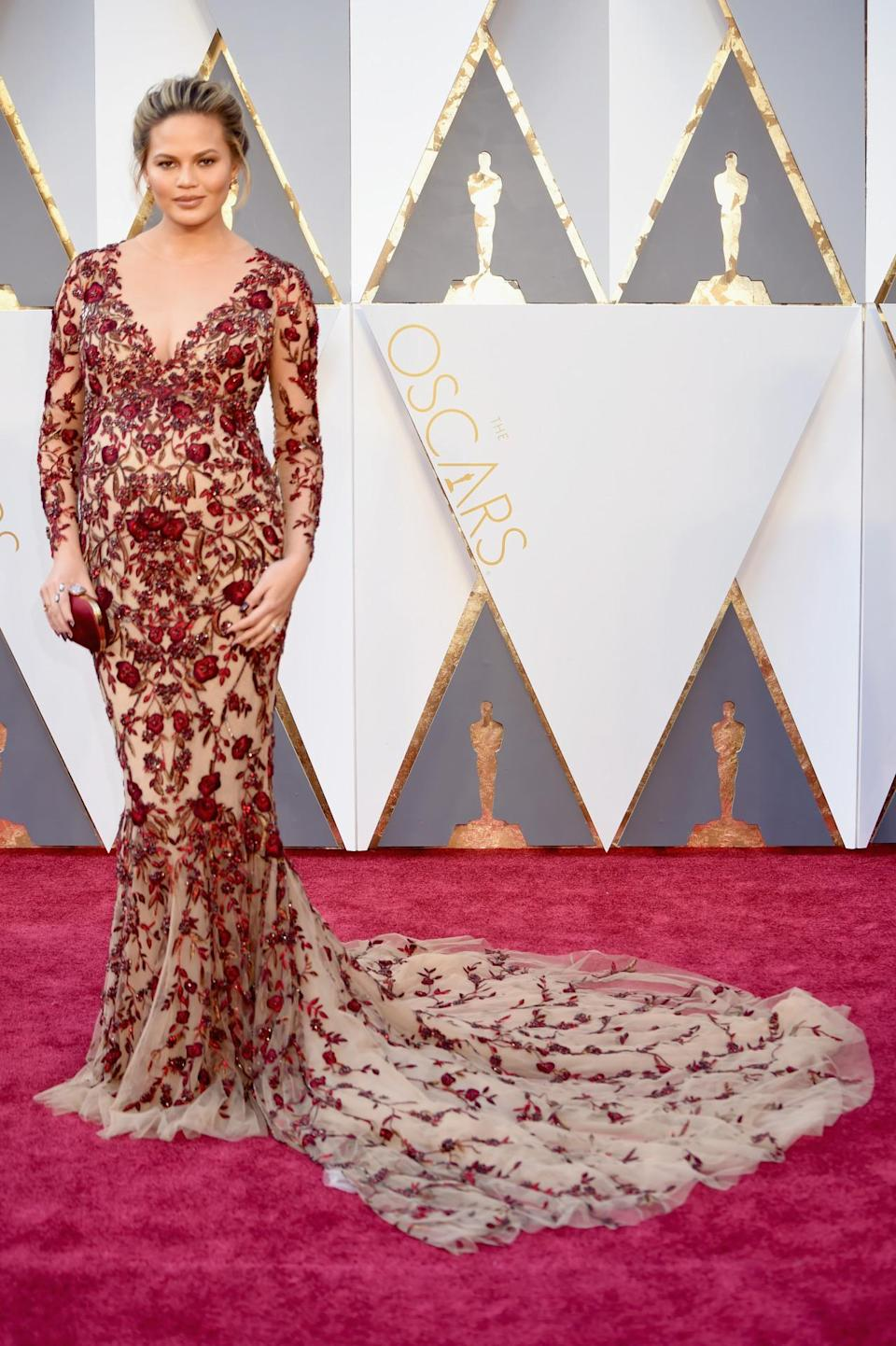 <p>Pregnant Chrissy Teigen wore a Marchesa naked dress to the Oscars, where her husband, John Legend, presented an award with collaborator Common. <i><i>(Photo: Getty Images)</i></i></p>