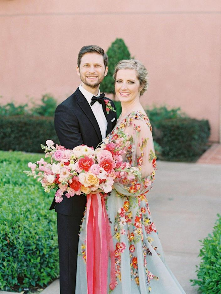 """For Cavin Elizabeth, a San Diego-based wedding photographer who married her husband in 2019, a white dress """"did not feel like it honored my personality,"""" she says.Instead, she opted for a blue gown with vibrant floral patterns."""