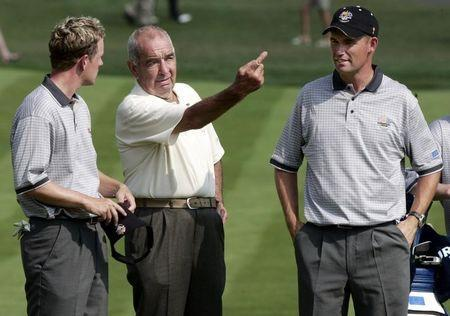 European golfers Ian Poulter (L) of England and Padraig Harrington (R) of Ireland talk to their coach Bob Torrance during practice for the 35th Ryder Cup Matches at the Oakland Hills Country Club in Bloomfield, Michigan September 15, 2004. REUTERS/Jeff J Mitchell PJ