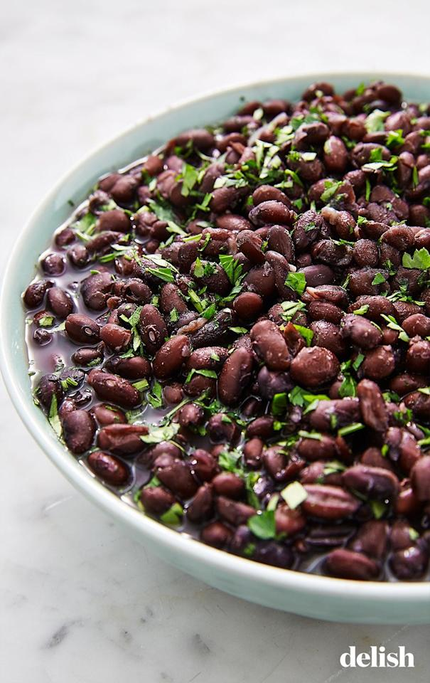 """<p>Unsure how to best prepare black beans from scratch? Look no further! Here's a primer to get you started.</p><p>Get the recipe from <a href=""""https://www.delish.com/cooking/a25656923/how-to-cook-black-beans/"""" target=""""_blank"""">Delish.</a></p>"""