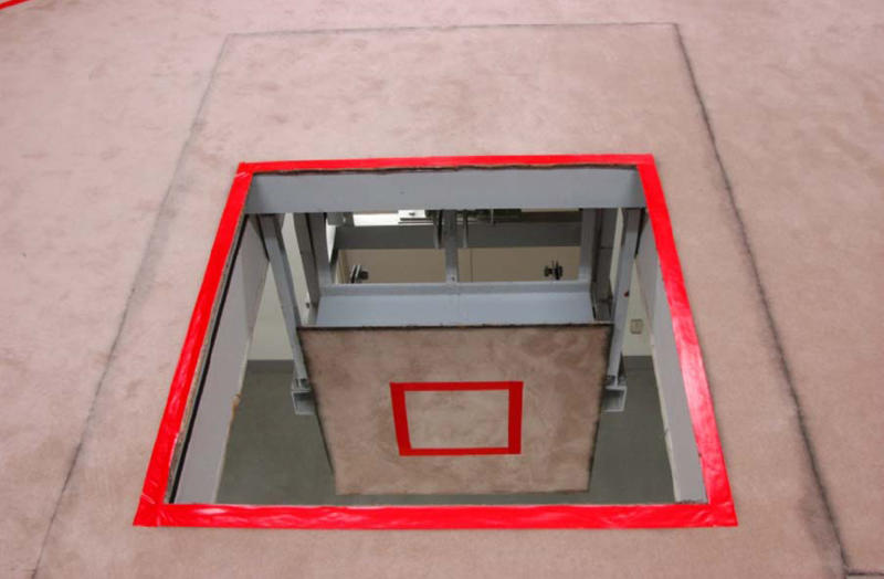 In this photo taken and released on Aug. 27, 2010 by Japan's Justice Ministry, the trapdoor where a condemned criminal is to stand is wide open downward in an execution room at Tokyo Detention Center when the local media are allowed a rare tour of Tokyo's main gallows in a bid to create more public awareness about capital punishment. Three death row inmates in Japan were executed by hanging on Thursday, March 29, 2012, the country's first executions in more than a year and a half. Japan, along with the United States, is one of the few industrialized countries that still has capital punishment. The room behind the glass window is for witnesses to stand and observe the execution. (AP Photo/Justice Ministry)  EDITORIAL USE ONLY, NO CROPPING ALLOWED
