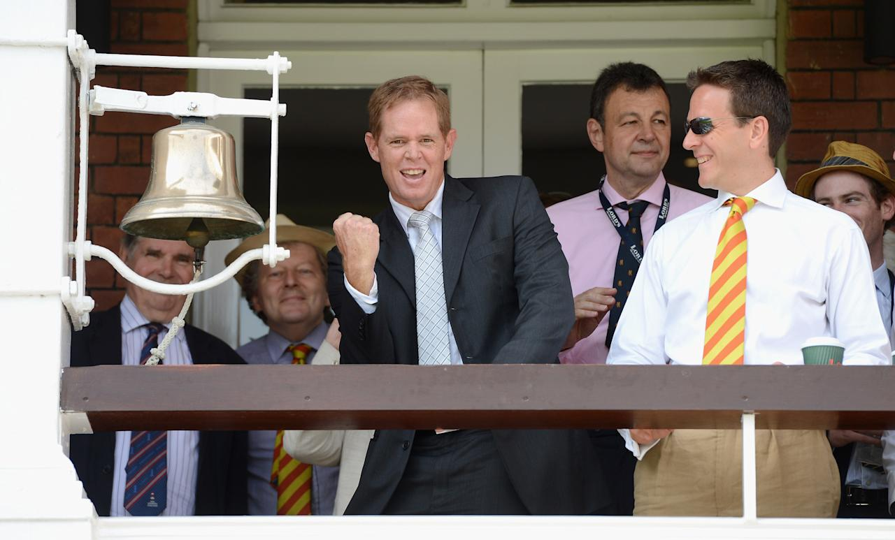 LONDON, ENGLAND - AUGUST 19:  Former South Africa cricketer Shaun Pollock rings the five minute bell ahead of day four of 3rd Investec Test match between England and South Africa at Lord's Cricket Ground on August 19, 2012 in London, England.  (Photo by Gareth Copley/Getty Images)