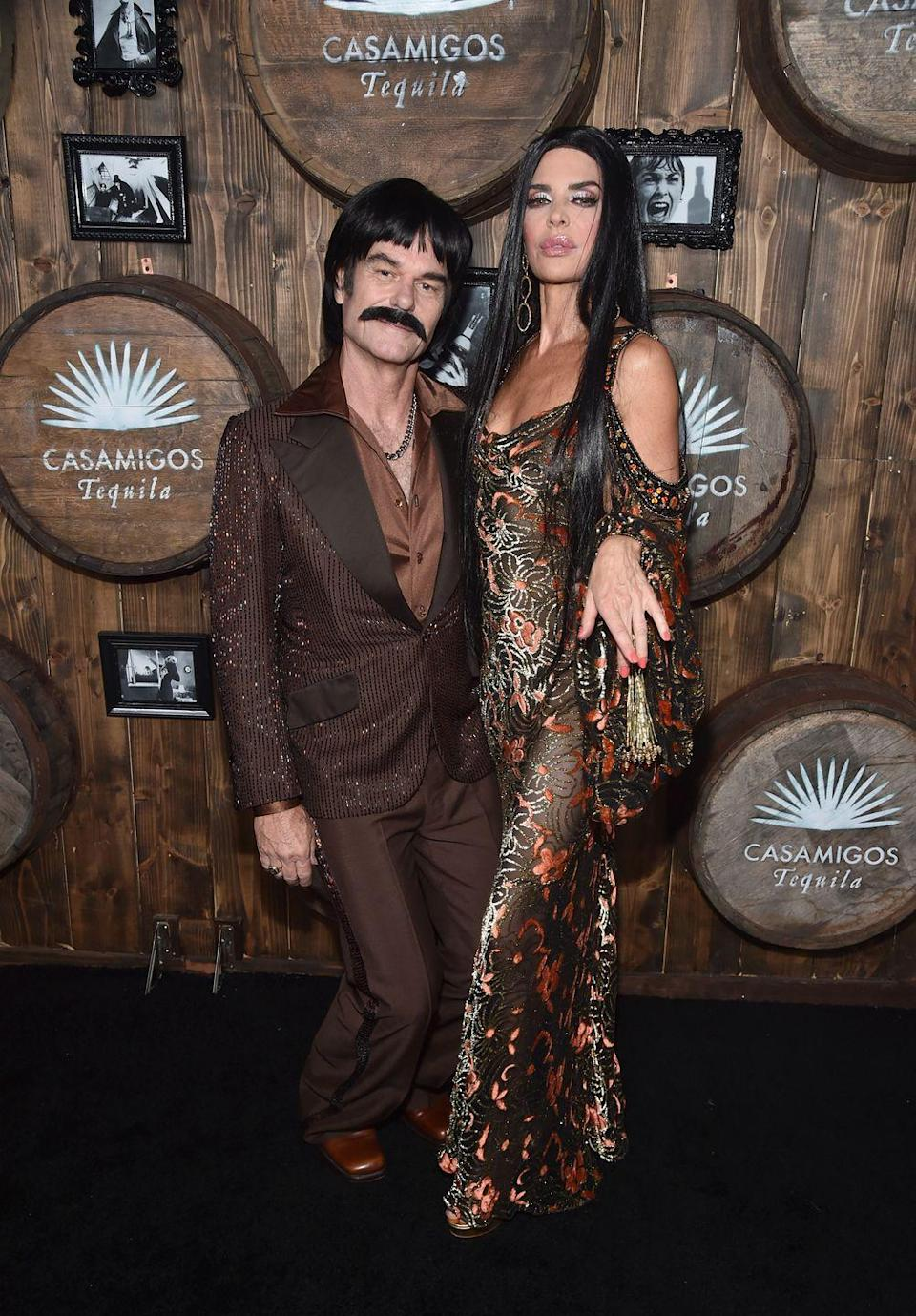 """<p>Coordinating ensembles and a seriously cool mustache will turn you and a friend into the musical duo Sonny and Cher.</p><p><a class=""""link rapid-noclick-resp"""" href=""""https://www.amazon.com/Rubies-Costume-Co-Zapata-Moustache/dp/B002SP102W?tag=syn-yahoo-20&ascsubtag=%5Bartid%7C10070.g.23122163%5Bsrc%7Cyahoo-us"""" rel=""""nofollow noopener"""" target=""""_blank"""" data-ylk=""""slk:SHOP MUSTACHE"""">SHOP MUSTACHE</a></p><p><a class=""""link rapid-noclick-resp"""" href=""""https://www.amazon.com/ALLAURA-Straight-Morticia-Costume-Halloween/dp/B077NNBPP5?tag=syn-yahoo-20&ascsubtag=%5Bartid%7C10070.g.23122163%5Bsrc%7Cyahoo-us"""" rel=""""nofollow noopener"""" target=""""_blank"""" data-ylk=""""slk:SHOP WIG"""">SHOP WIG</a></p>"""