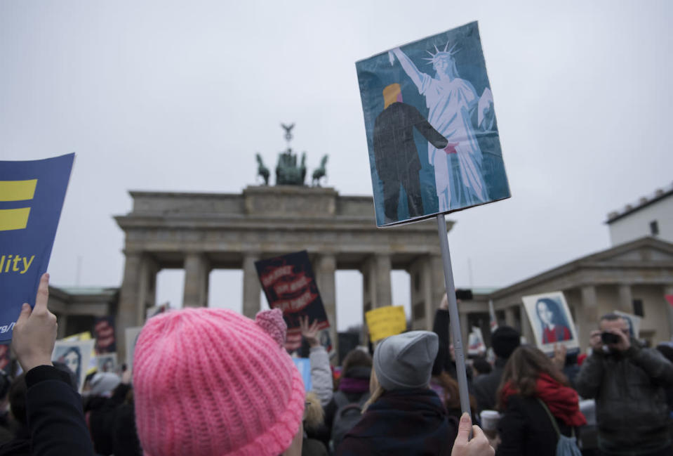 <p>Women and men attend a protest for women's rights and freedom in solidarity with the Women's March on Washington in front of the Brandenburg Gate in Berlin. (Photo: Getty Images) </p>