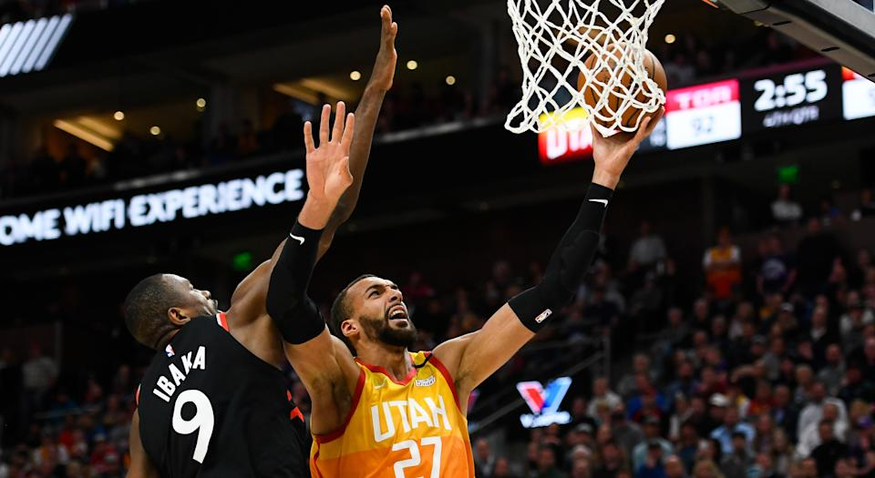 Serge Ibaka of the Toronto Raptors (left) has not contracted the coronavirus after guarding Rudy Gobert of the Utah Jazz in an NBA game on Monday. (Photo by Alex Goodlett/Getty Images)