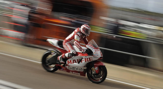 Mapfre Aspar Team's Spanish Hector Barbera enters the pit during Moto GP's second training session of Valencia's Grand Prix at Ricardo Tormo racetrack in Cheste, on November 04, 2011. AFP PHOTO / JOSE JORDAN (Photo credit should read JOSE JORDAN/AFP/Getty Images)