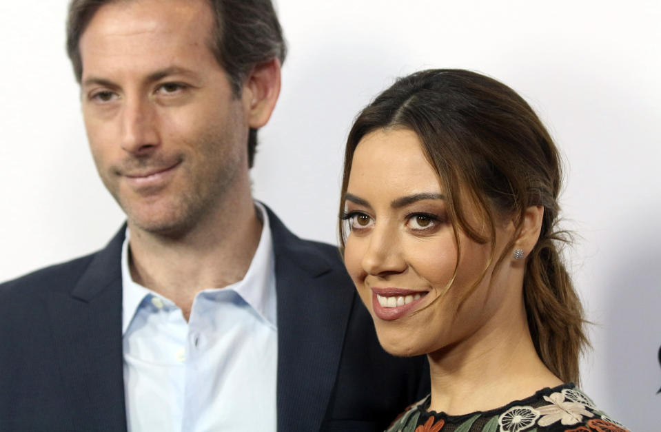 """FILE - In this Monday, June 19, 2017,, file photo, Aubrey Plaza, right, and Jeff Baena arrive at the premiere of """"The Little Hours"""" at the 2017 Los Angeles Film Festival in Culver City, Calif. Plaza has married her longtime boyfriend, director and screenwriter Baena. The """"Parks and Recreation"""" actor called Baena """"my husband"""" for the first time publicly Friday, May 7, 2021, in an Instagram post. (Photo by Willy Sanjuan/Invision/AP, File)"""