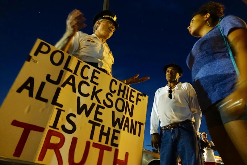 Retired Philadelphia police Captain Ray Lewis speaks with people on August 21, 2014 in Ferguson, Missouri