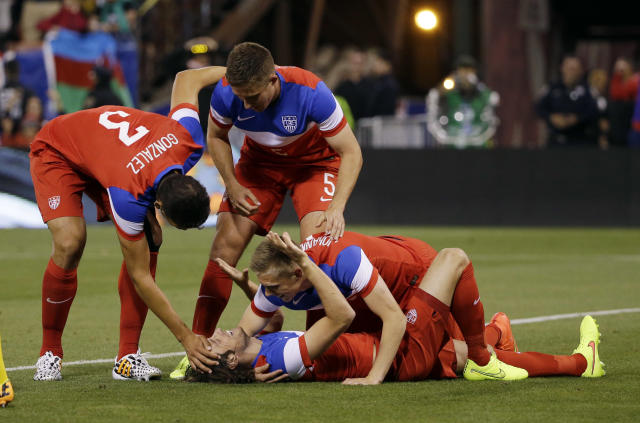 United States' Mix Diskerud, bottom, celebrates his goal with teammates during the second half of an international friendly soccer match against Azerbaijan on Tuesday, May 27, 2014, in San Francisco. United States won 2-0. (AP Photo/Marcio Jose Sanchez)