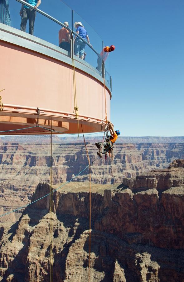 PIC BY GEORGE WALSH / ABSEILON USA / CATERS NEWS - (PICTURED: WORKERS CLEANING THE GLASS OF THE GRAND CANYON SKYWALK) - Dangling from ropes thousands of metres over the Grand Canyon - heres one cleaning job not for the faint-hearted. Workers enjoyed these breath-taking views as they polished the glass at the Grand Canyon Skywalk, a popular tourist attraction in Arizona, USA. The technicians from Abseilon USA had to clean more than 40 panes of glass underneath the horseshoe-shaped bridge. Its structure juts out 21m (70ft) from the edge of the Grand Canyon, offering visitors a view of the Colorado River 4000ft below. The Skywalk is at the west end of the Grand Canyon on the Hualapai reservation, outside the boundaries of Grand Canyon National Park.