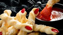 """<p>Want to do something creative for dinner on Halloween? Try this creepy breadstick recipe. Twist <a href=""""https://www.thedailymeal.com/best-recipes/best-pizza-recipes-and-pizza-cooking-ideas?referrer=yahoo&category=beauty_food&include_utm=1&utm_medium=referral&utm_source=yahoo&utm_campaign=feed"""" rel=""""nofollow noopener"""" target=""""_blank"""" data-ylk=""""slk:pizza dough"""" class=""""link rapid-noclick-resp"""">pizza dough</a> into finger-shaped breadsticks and add an almond slice to resemble a fingernail. Add a garlic and butter mixture and then sprinkle Parmesan cheese over it for a tasty-yet-frightening dish.</p> <p><a href=""""https://www.thedailymeal.com/recipes/bewitching-breadsticks-recipe?referrer=yahoo&category=beauty_food&include_utm=1&utm_medium=referral&utm_source=yahoo&utm_campaign=feed"""" rel=""""nofollow noopener"""" target=""""_blank"""" data-ylk=""""slk:For the Bewitching Breadsticks recipe, click here."""" class=""""link rapid-noclick-resp"""">For the Bewitching Breadsticks recipe, click here.</a></p>"""