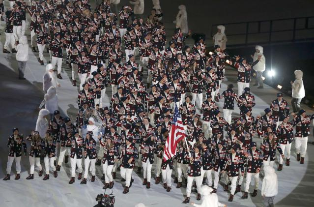 Flag-bearer Todd Lodwick of the U.S. leads his country's contingent during the opening ceremony of the 2014 Sochi Winter Olympics, February 7, 2014. REUTERS/Issei Kato (RUSSIA - Tags: OLYMPICS SPORT)