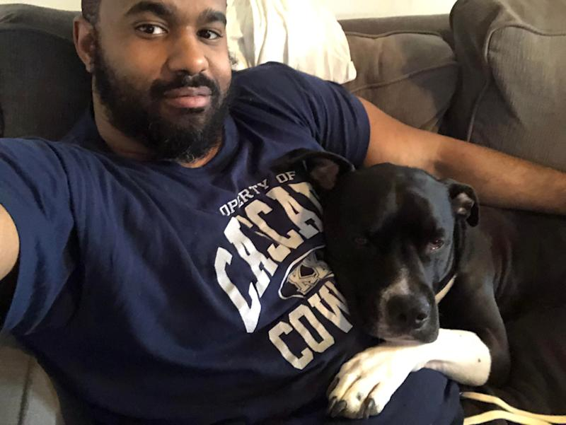Michael Tyler, a campaign staffer for Cory Booker, poses with his dog Gumbo. (Credit: Michael Tyler)