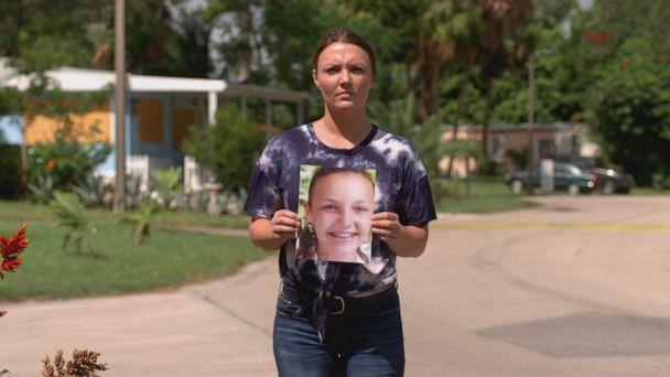 PHOTO: Courtney Wild is seen here holding a photo of her younger self. (ABC News)