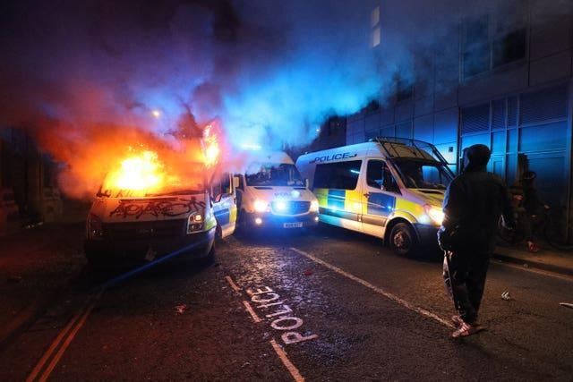 A vandalised police van on fire outside Bridewell police station in Bristol