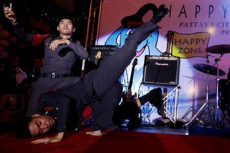 "Policemen dance during the launch of the ""Happy Zone"" program aiming to improve the image of the city in Pattaya, Thailand March 25, 2017. Picture taken March 25, 2017. REUTERS/Jorge Silva"