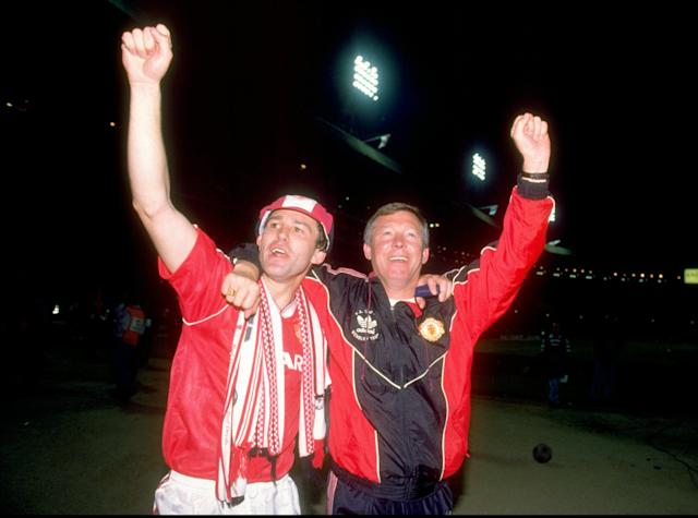 20 May 1990: Bryan Robson of Manchester United and Manager Alex Ferguson celebrate after their victory in the FA Cup Final against Crystal Palace at Wembley Stadium in London, England. Manchester United won the match 1-0 after extra time. \ Mandatory Credit: Allsport UK /Allsport