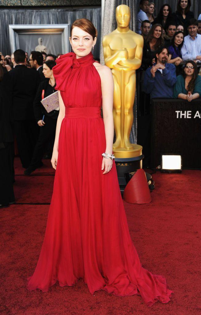 <p>One of our favourite's on the red carpet, Emma Stone, wore this beautiful high-neck Giambattista Valli dress at her first Oscars in 2012. The star has received three Oscar nominations since and won the Best Actress prize in 2017 for La La Land.</p>