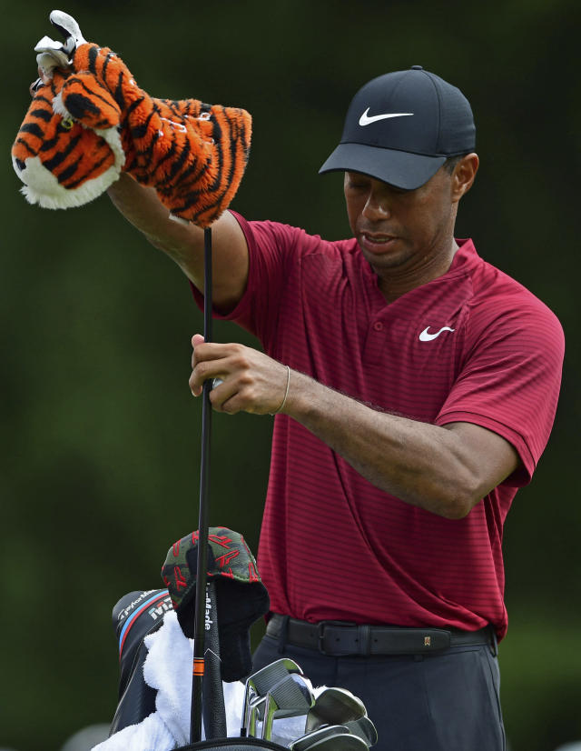 Tiger Woods selects his driver before teeing off on the fourth hole during the final round of the Bridgestone Invitational golf tournament at Firestone Country Club, Sunday, Aug. 5, 2018, in Akron, Ohio. (AP Photo/David Dermer)