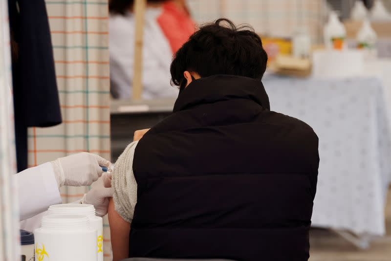 FILE PHOTO: A man gets an influenza vaccine at a hospital in Seoul