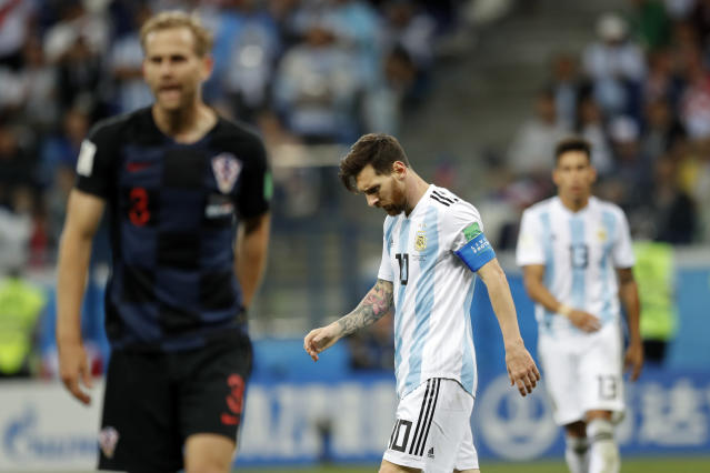 Argentina's Lionel Messi, center looks down after Croatia's Luka Modric scored his side's second goal during the group D match between Argentina and Croatia at the 2018 soccer World Cup in Nizhny Novgorod Stadium in Novgorod, Russia, Thursday, June 21, 2018. (AP Photo/Pavel Golovkin)