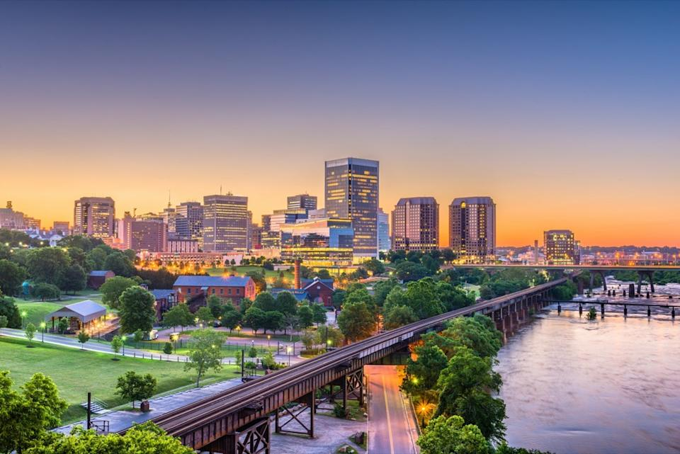 downtown skyline and river in Richmond, Virginia at twilight