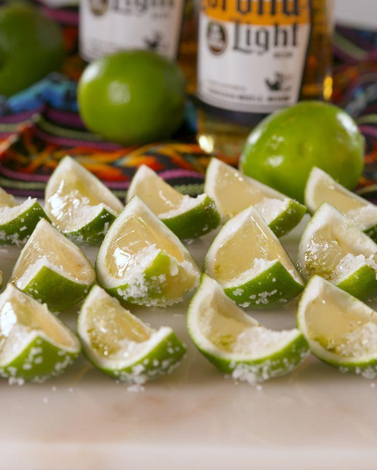 """<p>It's the classic beer and garnish combo in Jell-O shot form. </p><p><em><a href=""""https://www.delish.com/cooking/recipe-ideas/a20105664/corona-jell-o-shots-recipe/"""" rel=""""nofollow noopener"""" target=""""_blank"""" data-ylk=""""slk:Get the recipe from Delish »"""" class=""""link rapid-noclick-resp"""">Get the recipe from Delish »</a></em></p>"""