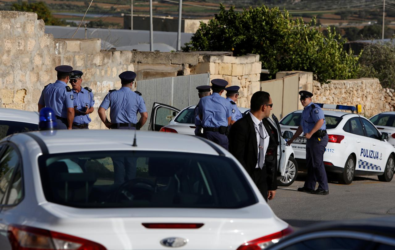Police officers stand nearby during a Mass celebrated by Archbishop of Malta Charles Scicluna for assassinated investigative journalist Daphne Caruana Galizia, killed in a car bomb attack a week ago, at the Church of the Holy Family in her home village of Bidnija, Malta October 23, 2017. REUTERS/Darrin Zammit Lupi