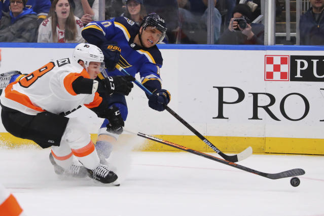 St. Louis Blues center Brayden Schenn (10) shoots the puck against Philadelphia Flyers center Tyler Pitlick (18) during the second period of an NHL hockey game Wednesday, Jan. 15, 2020 in St. Louis. (AP Photo/Dilip Vishwanat)