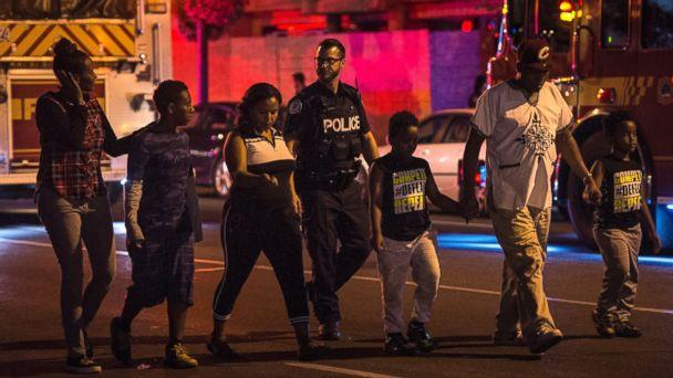 Police escort civilians away from the scene of a shooting, Sunday, July 22, 2018, in Toronto. (AP)