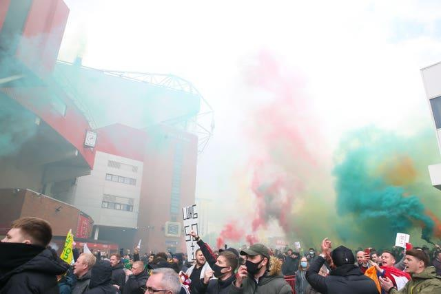 Manchester United fans make their way into Old Trafford as they protest against the Glazer family