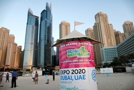 FILE PHOTO: A booth on a beach in Dubai carrying the Expo 2020 logo