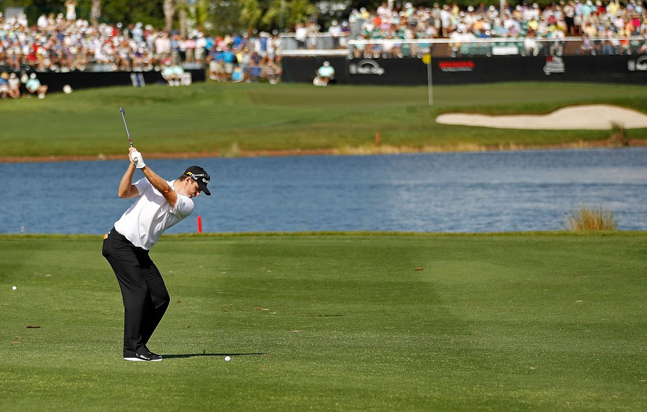 PALM BEACH GARDENS, FL - MARCH 02:  Justin Rose of England hits his approach shot  on the 16th hole during the second round of the Honda Classic at PGA National on March 2, 2012 in Palm Beach Gardens, Florida.  (Photo by Mike Ehrmann/Getty Images)
