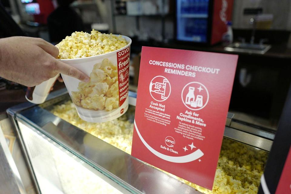 <p>A customer is seen buying popcorn at AMC DINE-IN Thoroughbred 20 on August 20 in Franklin, Tennessee.</p>