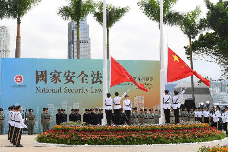 Chinese and Hong Kong flags are raised at the flag-raising ceremony for the 23rd anniversary of the establishment of the Hong Kong Special Administrative Region